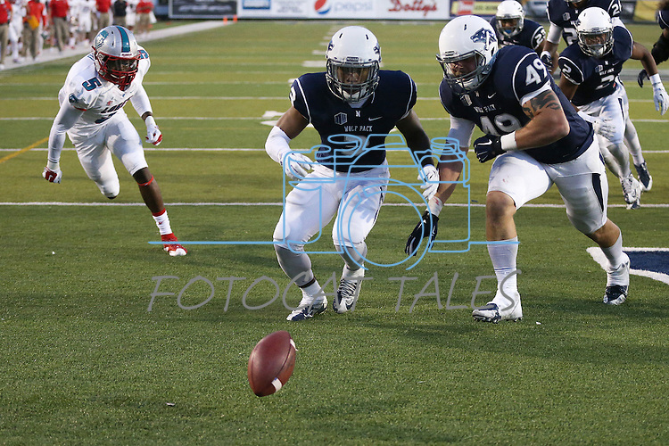 Nevada's Ahki Muhammad and Jordan Dobrich chase a ball fumbled into the end zone by New Mexico in an NCAA college football game in Reno, Nev., on Saturday, Oct. 10, 2015. Dobrich recovered the ball for a touchback. (AP Photo/Cathleen Allison)