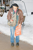 A person holds a campaign sign as they leave after Democratic presidential candidate and Massachusetts senator Elizabeth Warren spoke at a campaign rally at Rochester Opera House in Rochester, New Hampshire, on Mon., Feb. 10, 2020. This is the final day of campaigning before voting in the primary happens on Feb. 11. Warren has fallen to 4th or 5th place in recent polls.