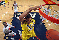 CHARLOTTESVILLE, VA- NOVEMBER 29: Jordan Morgan #52 of the Michigan Wolverines dunks the ball during the game on November 29, 2011 at the John Paul Jones Arena in Charlottesville, Virginia. Virginia defeated Michigan 70-58. (Photo by Andrew Shurtleff/Getty Images) *** Local Caption *** Jordan Morgan