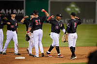 Batavia Muckdogs Kobie Taylor (38), J.D. Orr (22), Nic Ready (51), Albert Guaimaro (13), and Andrew Turner (9) celebrate after a NY-Penn League game against the West Virginia Black Bears on June 26, 2019 at Dwyer Stadium in Batavia, New York.  Batavia defeated West Virginia 4-2.  (Mike Janes/Four Seam Images)