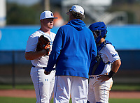 IMG Academy Ascenders pitching coach Ted Power talks with pitcher Skyler Brown (9) and catcher Will King (5) during a game against the Victory Charter School Knights on February 28, 2020 at IMG Academy in Bradenton, Florida.  (Mike Janes/Four Seam Images)