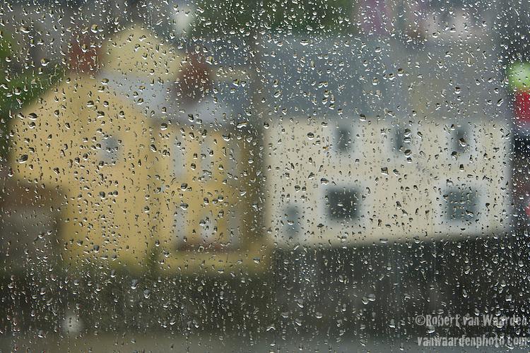 Rain drops on the window of a pub in Pembroke, Wales, the United Kingdom.
