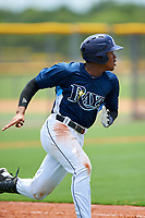 GCL Rays right fielder Pedro Diaz (9) runs to first base during the first game of a doubleheader against the GCL Twins on July 18, 2017 at Charlotte Sports Park in Port Charlotte, Florida.  GCL Twins defeated the GCL Rays 11-5 in a continuation of a game that was suspended on July 17th at CenturyLink Sports Complex in Fort Myers, Florida due to inclement weather.  (Mike Janes/Four Seam Images)