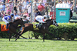 Eventual winner, Doubles Partner with Garrett Gomez (white cap) and Asphalt with Julien Leparoux run down the backstretch in The American Turf Stakes at Churchill Downs. 04.30.2010