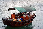 """BUMBOAT on the SINGAPORE RIVER<br /> <br /> A bumboat is a small boat used to ferry supplies to ships moored away from the shore. Originally referring to a scavenger's boat,the name comes from the combination of the Dutch word for a canoe—""""boomschuit"""" (""""boom"""" meaning """"tree""""),and """"boat""""."""