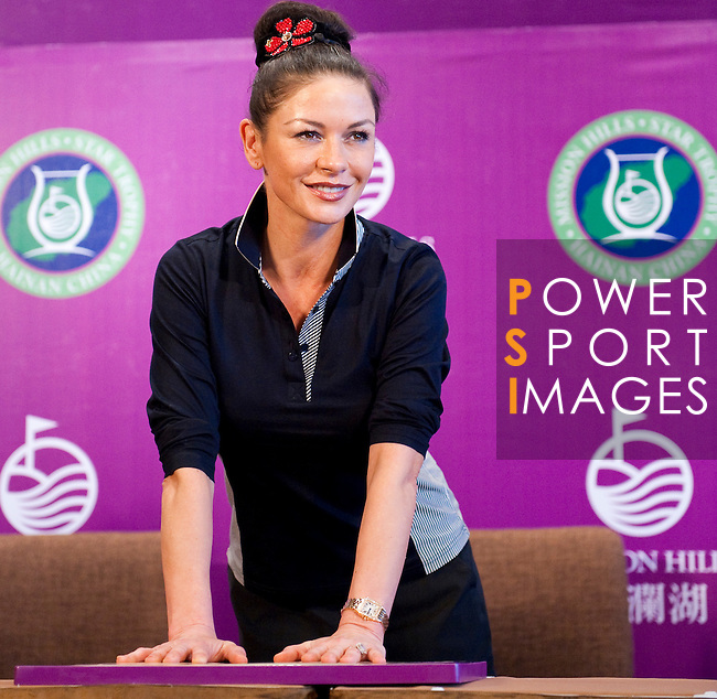HAIKOU, CHINA - OCTOBER 28: Oscar-winning actress Catherine Zeta-Jones makes a hand mould during a press conference as part of the Mission Hills Star Trophy on October 28, 2010 in Haikou, China. The Mission Hills Star Trophy is Asia's leading leisure liflestyle event and features Hollywood celebrities and international golf stars. Photo by Victor Fraile / The Power of Sport Images