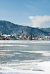 Germany, Bavaria, Upper Bavaria, Tegernseer Valley, Winter at Lake Tegern; view across the lake towards Rottach-Egern