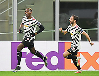 18th March 2021; San Siro stadium, Milan, Italy;  Manchester United, Manchater Uniteds Paul Pogba  celebrates scoring for 0-1 in the 48th minute during the Europa League round of 16 second leg match between AC Milan and Manchester United in Milan, Italy