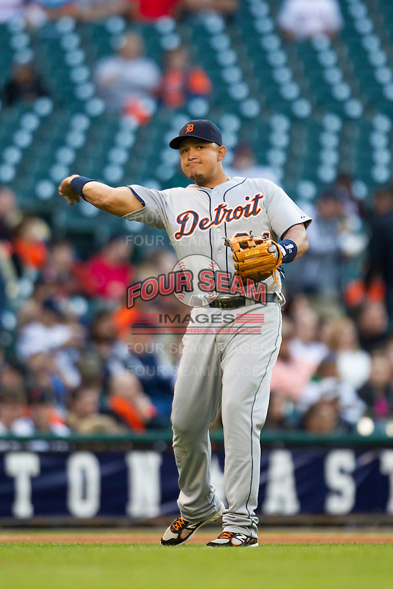 Detroit Tigers third baseman Miguel Cabrera (24) makes a throw to first base during the MLB baseball game against the Houston Astros on May 3, 2013 at Minute Maid Park in Houston, Texas. Detroit defeated Houston 4-3. (Andrew Woolley/Four Seam Images).