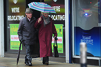 Pictured: A man and women walk as they battle with the wind and rain in Swansea City Centre, Swansea Wales, UK. Friday 08 February 2019<br /> Re: