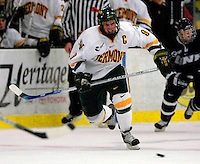 "5 January 2007: University of Vermont forward and co-captain Torrey Mitchell (9) from Greenfield Park, QC, in action against the University of New Hampshire Wildcats at Gutterson Fieldhouse in Burlington, Vermont. The UNH Wildcats defeated the UVM Catamounts 7-1 in front of a record setting 48th consecutive sellout at ""the Gut""...Mandatory Photo Credit: Ed Wolfstein Photo.<br />"