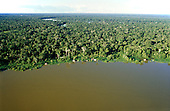 Jurua River, Amazonia, Brazil. Aerial view of winding river with caboclo houses on the nearest bank.