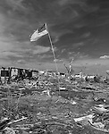 Greensburg, Kansas was hit by an F5 tornado on Friday, May 4th. Here is what is left of the city. 961 homes were destroyed, dozens of business and twelve people died. Also featured is a set of clubs that was found in the tornado debris.