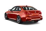 Car pictures of rear three quarter view of a 2018 BMW M3 4 Door Sedan Angular Rear