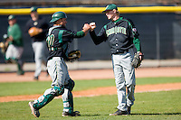 Catcher Zane Williams #10 and Patrick Lawson #14 of the Charlotte 49ers fist bump after closing out their 13-4 win over the North Carolina A&T Aggies at War Memorial Stadium March 23, 2010, in Greensboro, North Carolina.  Photo by Brian Westerholt / Four Seam Images