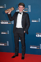 """Actor Niels Schneider holds his trophy during a photocall after receiving the Best Male Newcomer Award for his role in the film """"Diamant noir"""" (Dark Inclusion) at the 42nd Cesar Awards ceremony in Paris, France, February 24, 2017."""