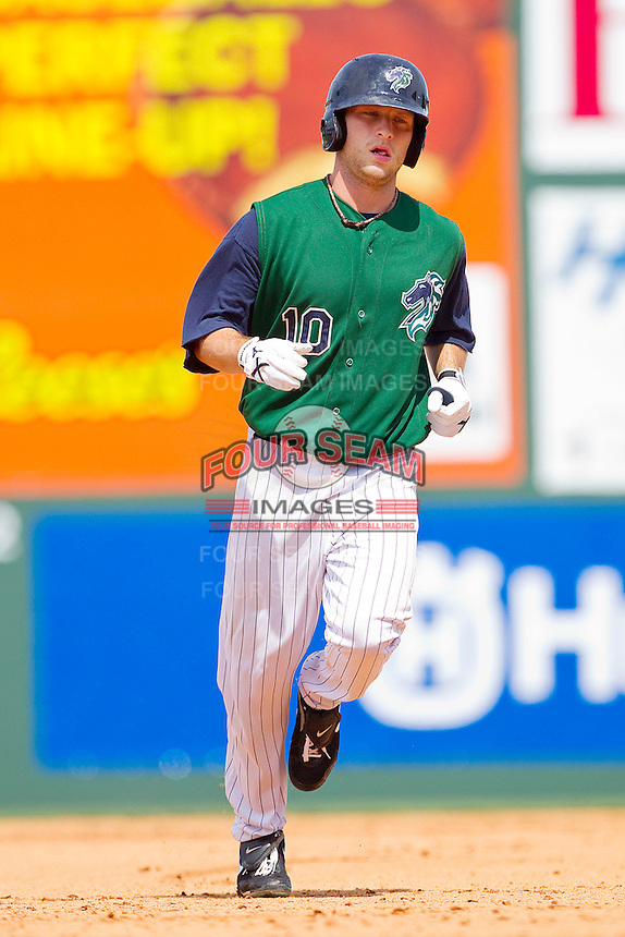 Jim Gallagher #10 of the Charlotte Knights rounds the bases after hitting a 2-run home run in the 5th inning against the Syracuse Chiefs at Knights Stadium on June 19, 2011 in Fort Mill, South Carolina.  The Knights defeated the Chiefs 10-9.    (Brian Westerholt / Four Seam Images)