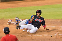 AZL Indians 1 right fielder Johnathan Rodriguez (30) slides across home plate ahead of the tag from catcher David Garcia (9) during an Arizona League playoff game against the AZL Rangers at Goodyear Ballpark on August 28, 2018 in Goodyear, Arizona. The AZL Rangers defeated the AZL Indians 1 7-4. (Zachary Lucy/Four Seam Images)