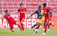 25th August 2020, Red Bull Arena, Slazburg, Austria; Pre-season football friendly, Red Bull Salzburg versus Liverpool FC;  James Milner  and Takumi Minamino of Liverpool tackle Enock Mwepu FC Red Bull Salzburg wacthed by Georginio Wijnaldum FC Liverpool