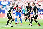 Atletico de Madrid's player Ángel Martín Correa and Sporting de Gijon's player Fernando Amorebieta and Ignacio Cases during a match of La Liga Santander at Vicente Calderon Stadium in Madrid. September 17, Spain. 2016. (ALTERPHOTOS/BorjaB.Hojas)