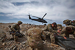 Members of 2nd Platoon, Comanche Company, 1-501 IN (ABN) (Task Force Blue Geronimo) out of Fort Richardson Alaska receive a resupply airdrop on day 3 of a 4-day mission in the mountains that overlook the border with Pakistan. The purpose of the mission was to survey the area for possible insurgency activity as well as to search surrounding villages for possible weapons caches. ..International forces are increasingly relying on Afghan National Security Forces (ANSF) such as the Afghan National Army  (ANA) in conducting village searches, key village leader engagements and biometrics intelligence gathering operations in preparation for the 2013 handover of security operations to the ANSF.