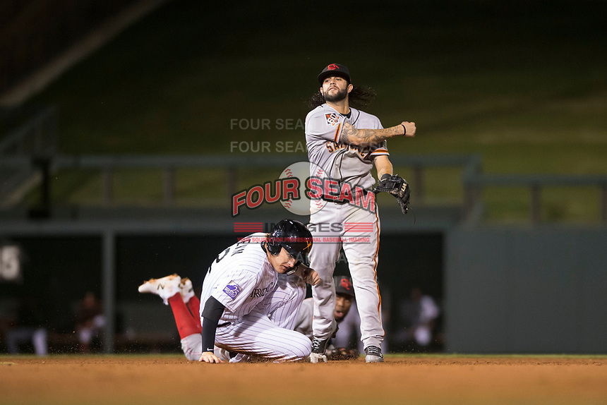 Scottsdale Scorpions second baseman C.J. Hinojosa (8), of the San Francisco Giants organization, throws to first base to complete a double play as Tyler Nevin (2) slides into second base during an Arizona Fall League game against the Salt River Rafters at Salt River Fields at Talking Stick on October 11, 2018 in Scottsdale, Arizona. Salt River defeated Scottsdale 7-6. (Zachary Lucy/Four Seam Images)