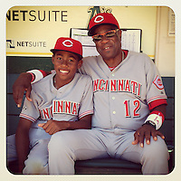 OAKLAND, CA - JUNE 26:  Instagram of Darren Baker and Dusty Baker of the Cincinnati Reds sitting in the dugout before the game against the Oakland Athletics at O.co Coliseum on June 26, 2013 in Oakland, California. Photo by Brad Mangin