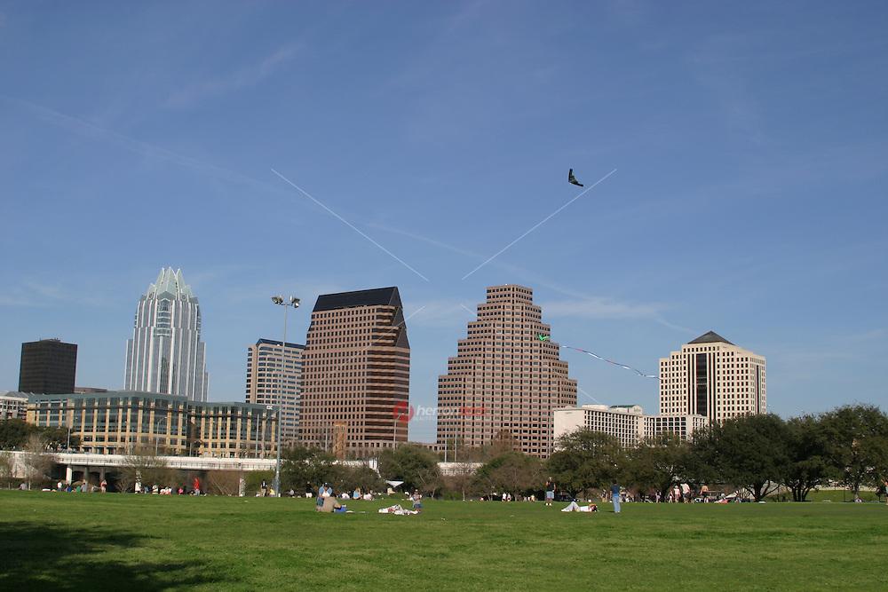 A favorite Austin pastime is flying a kite on Auditorium Shores on Town Lake Austin