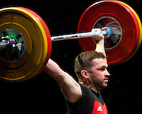 10 MAY 2014 - COVENTRY, GBR - Calum McNamara from Bethnal Green Weightlifting Club attempts to hold a lift during the men's 77kg B category round at the British 2014 Senior Weightlifting Championships and final 2014 Commonwealth Games qualifying event round at the Ricoh Arena in Coventry, Great Britain (PHOTO COPYRIGHT © 2014 NIGEL FARROW, ALL RIGHTS RESERVED)