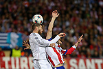 Atletico de Madrid's Raul Garcia (R) and Real Madrid´s Sergio Ramos during quarterfinal first leg Champions League soccer match at Vicente Calderon stadium in Madrid, Spain. April 14, 2015. (ALTERPHOTOS/Victor Blanco)