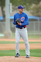 Chris Carpenter #60 of the Chicago Cubs participates in pitchers fielding practice during spring training workouts at the Cubs complex on February 19, 2011  in Mesa, Arizona. .Photo by Bill Mitchell / Four Seam Images.