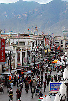 Tibetans in the market streets of Central Lhasa, mingle with tourists, Tibet, China. Lhasa is becomming swamped by tourists, especially Chinese, with the recently opened Golmud to Lhasa train and more and more flights arriving on a daily basis..6