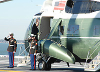 President George W. Bush waves to U.S. Sailors while boarding Marine One, a VH-3 Sea King helicopter assigned the ?Nighthawks? of Marine Helicopter Squadron One, prior to departing USS George H. W. Bush (CVN 77) following the ship?s commissioning ceremony on Naval Station Norfolk, Va., Jan. 10, 2009. The ship, which is the Navy?s newest and last Nimitz-class nuclear-powered aircraft carrier, is named for Bush?s father, President George H. W. Bush, the country?s 41st president. (U.S. Navy photo by Mass Communication Specialist 1st Class Susan Caraballo/Released)