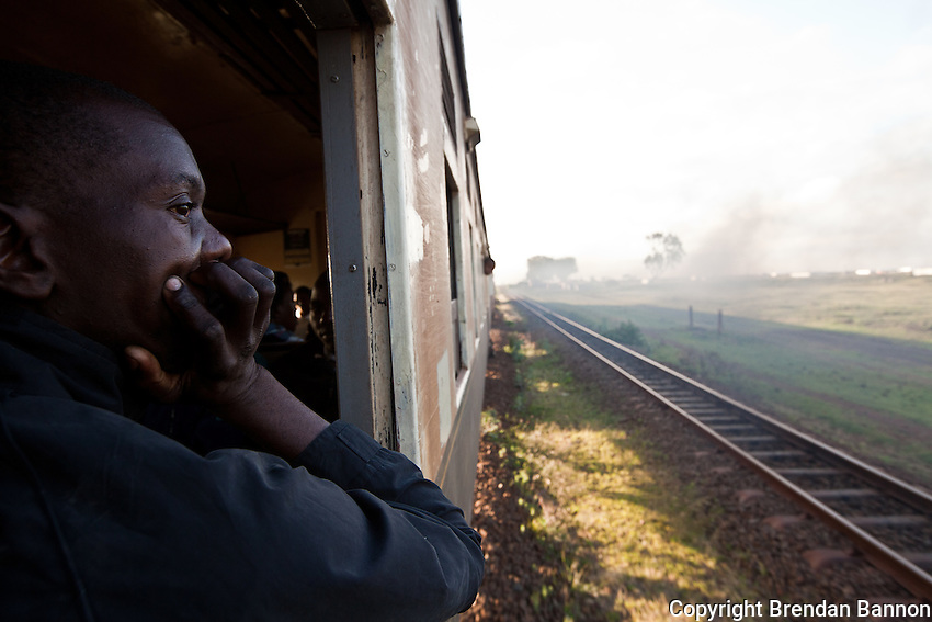 """Paul Okonji, 37, welder in Industrial Area, rides the train from Athi River to Nairobi, """"I thought I was being deceived to hear that there was a train every day from my home straight to near my work. But I tried it one day, it's so good. How can I go by matatu now? That would be senseless compared to this."""""""