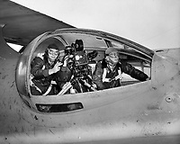 The Photo squadron personal, planes, and cameras equipment.  A Mitchell takes movies from PBY blister.