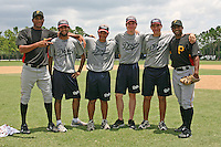 "July 13, 2009:  Pitchers Dinesh Patel (right) and Rinku Singh (left) of the GCL Pirates pose for a photo with four campers from the Doyle Baseball Academy in between a double header at Tiger Town in Lakeland, FL.  Three campers are from India while one has lived there for twelve years.  Patel and Singh were signed out of India through the contest ""The Million Dollar Arm"".  The GCL Pirates are the Gulf Coast Rookie League affiliate of the Pittsburgh Pirates.  Photo By Mike Janes/Four Seam Images"