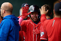 New Hampshire Fisher Cats third baseman Vladimir Guerrero Jr. (27) celebrates with his teammates in the dugout during the first game of a doubleheader against the Harrisburg Senators on May 13, 2018 at FNB Field in Harrisburg, Pennsylvania.  New Hampshire defeated Harrisburg 6-1.  (Mike Janes/Four Seam Images)