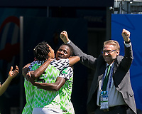 GRENOBLE, FRANCE - JUNE 12: Onome Ebi #5 of the Nigerian National Team, Chidinma Okeke #20 of the Nigerian National Team, Thomas Dennerby goal celebration during a game between Korea Republic and Nigeria at Stade des Alpes on June 12, 2019 in Grenoble, France.