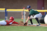 Jamestown Jammers firs baseman David Andriese (24) picks a throw as Aaron Blanton (11) dives back to first during a game against the Batavia Muckdogs on July 25, 2014 at Dwyer Stadium in Batavia, New York.  Batavia defeated Jamestown 7-2.  (Mike Janes/Four Seam Images)