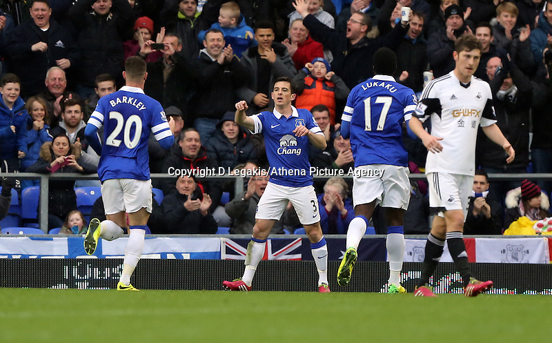 Pictured: Leighton Baines of Everton (C) is celebrating his opening goal from the penalty spot. Saturday 22 March 2014<br /> Re: Barclay's Premier League, Everton v Swansea City FC at Goodison Park, Liverpool, UK.