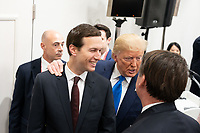 President Donald Trump speaks with Senior Advisor to the President Jared Kushner following the G20 Women's Empowerment Event in Osaka, Japan. (Official White House Photo by Shealah Craighead)