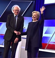 MIAMI, FL - MARCH 9: (Embargoed Till 03/11/2016) Democratic presidential candidates Senator Bernie Sanders (D-VT) and Democratic presidential candidate Hillary Clinton are seen before the Univision News and Washington Post Democratic Presidential Primary Debate on the Miami Dade College Kendall Campus on March 9, 2016 in Miami, Florida<br /> <br /> People:  Bernie Sanders, Hillary Clinton<br /> <br /> <br /> www.StormsMediaGroup.com