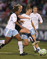 Allie Long (center) of the Washington Freedom squeezes between Ifeoma Dieke (4) and Ella Masar (3) of the Chicago Red Stars during a WPS match at Maryland Soccerplex on April 11 2009, in Boyd's, Maryland.  The game ended in a 1-1 tie.