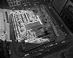 View of Mellon Square Construction from the roof of Kaufmann's department store. Mellon Square, built-in 1953-55 was designed by Mitchell & Ritchey, landscaped by Simonds & Simonds, and paid for by Mellon family foundations.  Rumor has it that the park was built to keep Alcoa Corporation from moving from Pittsburgh to New York City in the early 1950s.  Other buildings in the photo include William Penn Hotel.