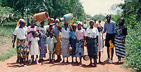 Local musicians on their way to perform, Accra, Ghana, Africa.