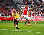 Nederland, Amsterdam, 19 april 2015<br /> Eredivisie<br /> Seizoen 2014-2015<br /> Ajax-NAC Breda (0-0)<br /> Anwar El Ghazi van Ajax en Kenny van der Weg van NAC Breda strijden om de bal