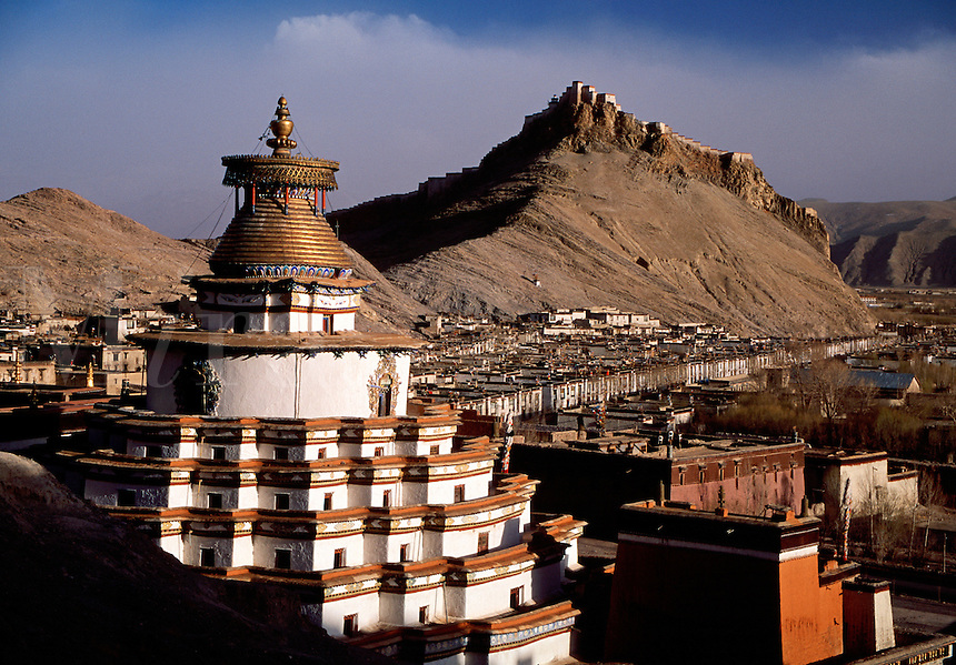 View to Gyantse Dzong old fort with Kumbum Stupa in foreground Gyantse Tibet China.