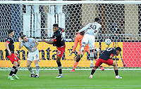 WASHINGTON, DC - NOVEMBER 8: Romell Quioto #30 of Montreal Impact heads the ball against Bill Hamid #24 of D.C. United during a game between Montreal Impact and D.C. United at Audi Field on November 8, 2020 in Washington, DC.