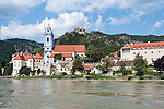Austria, Lower Austria, UNESCO World Heritage Wachau, view from Danube at wine town Duernstein with the blue-white tower of the Collegiate Church and Castle Ruin Duernstein, the legend says that King Richard I Lionheart has been kept imprisoned 1192 untill 1194