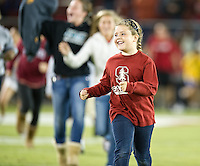 STANFORD, CA - April 14, 2012: Kids Running the Field after the Stanford Cardinal vs San Jose St. game at Stanford Stadium at Sanford, CA. Final score Stanford 20, San Jose St. 17..